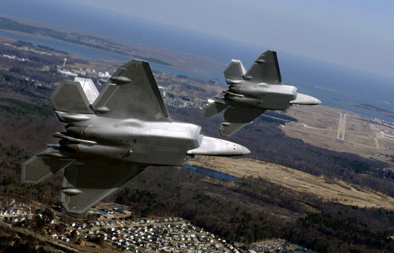 56. Delivering Two, New U.S. Air Force F-22A Raptor Stealth Fighter Jets to Langley Air Force Base (AFB), March 3, 2006, Commonwealth of Virginia, USA. Photo Credit: Tech. Sgt. Ben Bloker, United States Air Force; Defense Visual Information (DVI, http://www.DefenseImagery.mil, 060303-F-YL744-338, DF-SD-08-33417, and DFSD0833417) and United States Air Force (USAF, http://www.af.mil), United States Department of Defense (DoD, http://www.DefenseLink.mil or http://www.dod.gov), Government of the United States of America (USA).