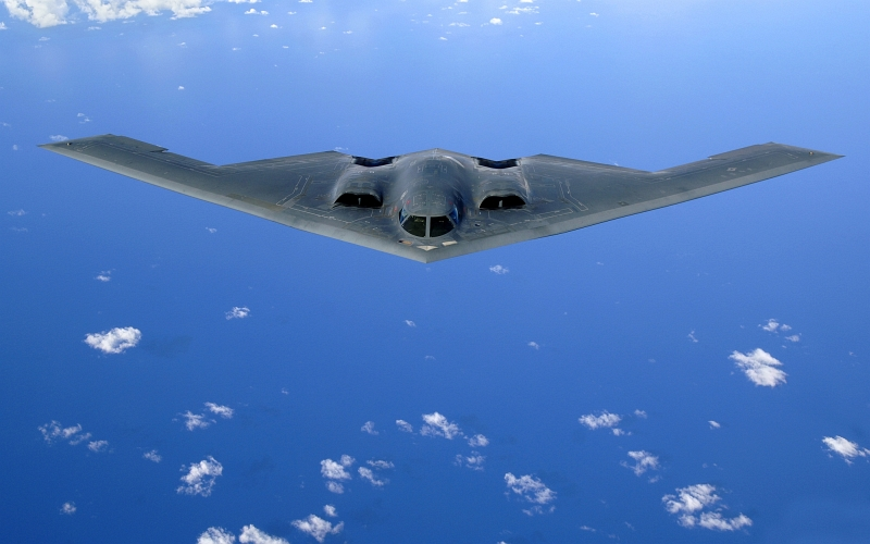 38. A U.S. Air Force B-2 Spirit Stealth Bomber Soars Over the Pacific Ocean After An Aerial Refueling Mission, May 30, 2006. Photo Credit: Staff Sgt. Bennie J. Davis III, Air Force Link - Photos (http://www.af.mil/photos, 060530-F-5040D-220, 'Over the Pacific'), United States Air Force (USAF, http://www.af.mil), United States Department of Defense (DoD, http://www.DefenseLink.mil or http://www.dod.gov), Government of the United States of America (USA).