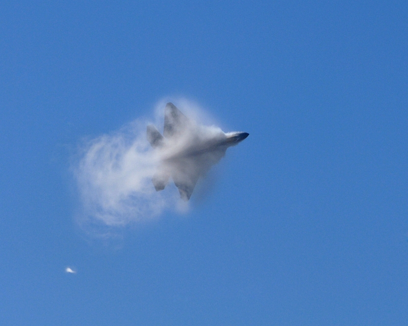9. A U.S. Air Force F-22A Raptor Stealth Fighter Jet Executing A Maneuver Through A Cloud of Vapor While Performing At the 42nd Naval Base Ventura County Air Show, April 1, 2007, Point Mugu, State of California, USA. Photo Credit: Technical Sgt. Alex Koenig, United States Air Force; Defense Visual Information (DVI, http://www.DefenseImagery.mil, 070401-F-6278K-057) and United States Air Force (USAF, http://www.af.mil), United States Department of Defense (DoD, http://www.DefenseLink.mil or http://www.dod.gov), Government of the United States of America (USA).
