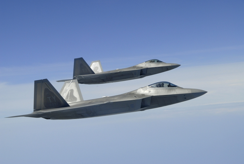 35. Two U.S. Air Force F-22A Raptor Stealth Fighter Jets Fly In the Observation Position As They Prepare For Refueling, April 2, 2007, Over the Gulf Coast, State of Florida, USA. Photo Credit: Senior Master Sgt. Thomas Meneguin, United States Air Force; Defense Visual Information (DVI, http://www.DefenseImagery.mil, 070402-F-WI667-006) and United States Air Force (USAF, http://www.af.mil), United States Department of Defense (DoD, http://www.DefenseLink.mil or http://www.dod.gov), Government of the United States of America (USA).