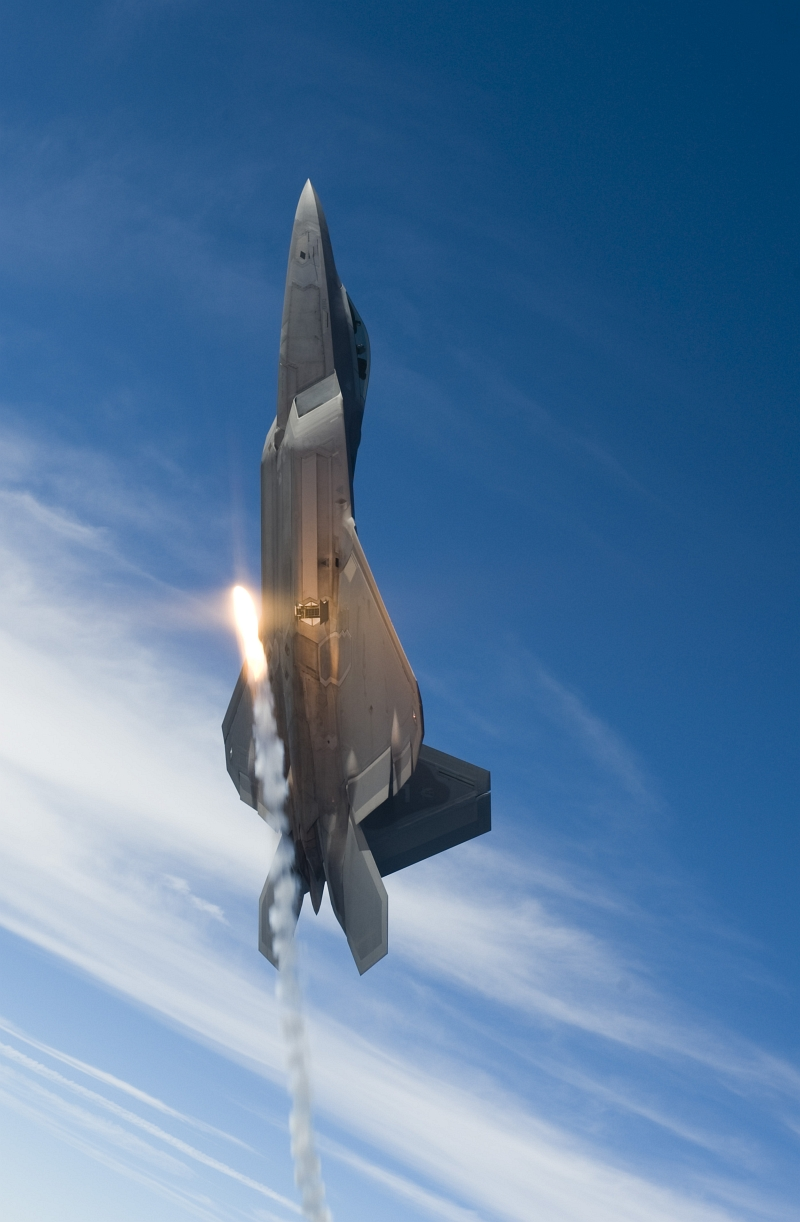 33. Going Vertical, A U.S. Air Force F-22A Raptor Stealth Fighter Jet Fires One Flare During A Sortie Over the Gulf of Mexico, August 27, 2008, New Orleans Naval Air Station, State of Louisiana, USA. Photo Credit: Staff Sgt. James L. Harper Jr., United States Air Force; Defense Visual Information (DVI, http://www.DefenseImagery.mil, 080827-F-4177H-096) and United States Air Force (USAF, http://www.af.mil), United States Department of Defense (DoD, http://www.DefenseLink.mil or http://www.dod.gov), Government of the United States of America (USA).