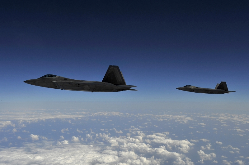 15. Two U.S. Air Force F-22A Raptor Stealth Fighter Jets Fly High Above Kadena Air Base, Okinawa, Nippon-koku (Nihon-koku) - Japan, on January 15, 2009. Photo Credit: Senior Airman Clay Lancaster, United States Air Force; Defense Visual Information (DVI, http://www.DefenseImagery.mil, 090115-F-0623L-452) and United States Air Force (USAF, http://www.af.mil), United States Department of Defense (DoD, http://www.DefenseLink.mil or http://www.dod.gov), Government of the United States of America (USA).