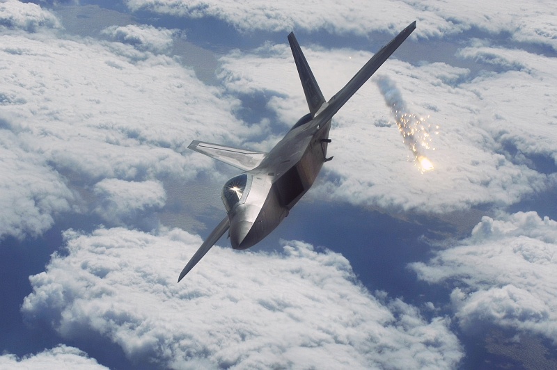 8. A United States Air Force F-22A Raptor Stealth Fighter Jet Deploys Flares High Above Kadena Air Base, Okinawa, Nippon-koku (Nihon-koku) - Japan, January 15, 2009. Photo Credit: Senior Airman Clay Lancaster, United States Air Force; Defense Visual Information (DVI, http://www.DefenseImagery.mil, 090115-F-0623L-885) and United States Air Force (USAF, http://www.af.mil), United States Department of Defense (DoD, http://www.DefenseLink.mil or http://www.dod.gov), Government of the United States of America (USA).