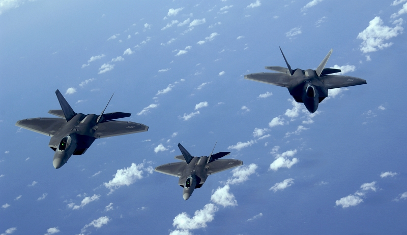 24. Three U.S. Air Force F-22A Raptor Stealth Fighters Flying Over the Pacific Ocean, January 28, 2009. Photo Credit: Master Sgt. Kevin J. Gruenwald, United States Air Force; Defense Visual Information (DVI, http://www.DefenseImagery.mil, 090128-F-6911G-047) and United States Air Force (USAF, http://www.af.mil), United States Department of Defense (DoD, http://www.DefenseLink.mil or http://www.dod.gov), Government of the United States of America (USA).