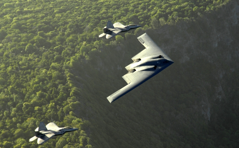 4. The B-2 Spirit and Two F-22A Raptor Fighters Fly In Formation Above the Cliffs, April 7, 2009, Territory of Guam, USA. Photo Credit: Master Sgt. Kevin J. Gruenwald, United States Air Force; Defense Visual Information (DVI, http://www.DefenseImagery.mil, 090414-F-6911G-004) and United States Air Force (USAF, http://www.af.mil), United States Department of Defense (DoD, http://www.DefenseLink.mil or http://www.dod.gov), Government of the United States of America (USA).