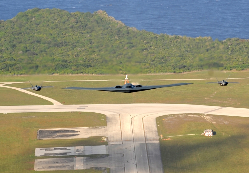 1. Two U.S. Air Force F-22A Raptor Stealth Fighter Jets and One U.S. Air Force B-2 Spirit Stealth Bomber Fly In Formation Over Andersen Air Force Base, April 14, 2009, Territory of Guam, USA. Photo Credit: Master Sgt. Kevin J. Gruenwald, United States Air Force (USAF, http://www.af.mil); Defense Visual Information (DVI, http://www.DefenseImagery.mil, 090414-F-6911G-008) and United States Air Force (USAF, http://www.af.mil), United States Department of Defense (DoD, http://www.DefenseLink.mil or http://www.dod.gov), Government of the United States of America (USA).