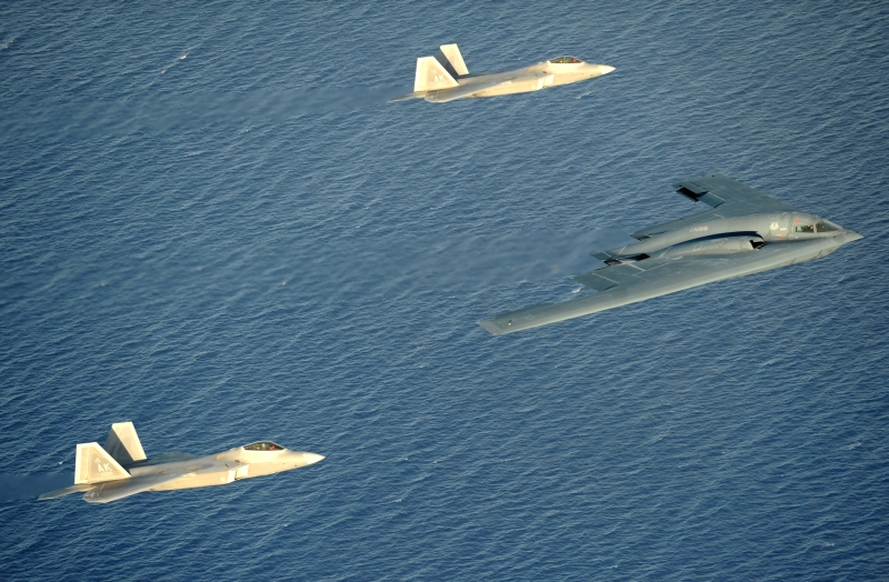 3. The B-2 Spirit Stealth Bomber and Two F-22A Raptor Fighters Flying In Formation Over the Pacific Ocean, April 7, 2009, Territory of Guam, USA. Photo Credit: Master Sgt. Kevin J. Gruenwald, United States Air Force; Defense Visual Information (DVI, http://www.DefenseImagery.mil, 090414-F-6911G-009) and United States Air Force (USAF, http://www.af.mil), United States Department of Defense (DoD, http://www.DefenseLink.mil or http://www.dod.gov), Government of the United States of America (USA).