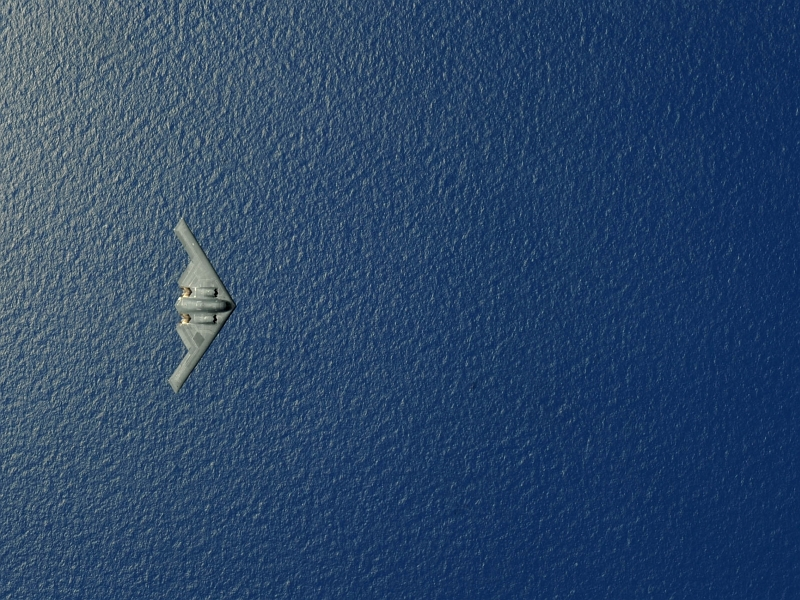 7. View From Above: A U.S. Air Force B-2 Spirit Stealth Bomber, Assigned to the 13th Expeditionary Bomb Squadron and Deployed to Territory of Guam, USA, Flies Over the Western Pacific Ocean During An Aerial Refueling Mission, May 12, 2009. Photo Credit: Senior Airman Christopher Bush, United States Air Force; Defense Visual Information (DVI, http://www.DefenseImagery.mil, 090512-F-2482B-025) and United States Air Force (USAF, http://www.af.mil), United States Department of Defense (DoD, http://www.DefenseLink.mil or http://www.dod.gov), Government of the United States of America (USA).