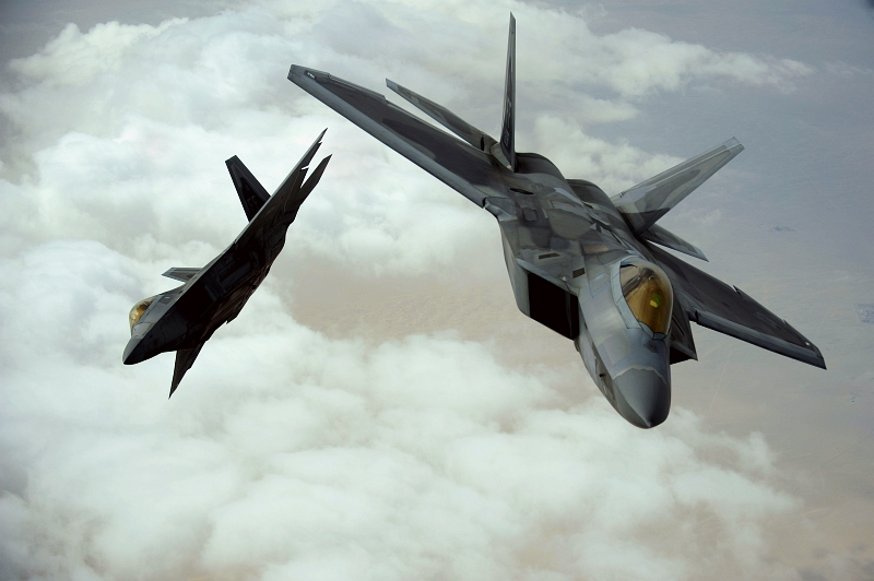 12. Two U.S. Air Force F-22A Raptor Stealth Fighter Jets (Deployed From the 27th Fighter Squadron at Langley Air Force Base in Virginia, USA) Flying Together Over Southwest Asia During A Training Mission At the Iron Falcon Exercise on December 6, 2009, United Arab Emirates - Al Imarat al Arabiyah al Muttahidah. Photo Credit: Staff Sgt. Michael B. Keller, United States Air Force; Defense Visual Information (DVI, http://www.DefenseImagery.mil, 091206-F-8155K-0150) and United States Air Force (USAF, http://www.af.mil), United States Department of Defense (DoD, http://www.DefenseLink.mil or http://www.dod.gov), Government of the United States of America (USA).