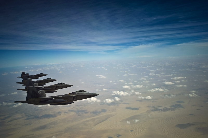 11. Four U.S. Air Force F-22A Raptor Stealth Fighter Jets (Deployed From the 27th Fighter Squadron at Langley Air Force Base in Virginia, USA) Fly In Formation Over Southwest Asia During A Training Mission at the Iron Falcon Exercise on December 9, 2009, United Arab Emirates - Al Imarat al Arabiyah al Muttahidah. Photo Credit: Staff Sgt. Michael B. Keller, United States Air Force; Defense Visual Information (DVI, http://www.DefenseImagery.mil, 091209-F-8155K-064) and United States Air Force (USAF, http://www.af.mil), United States Department of Defense (DoD, http://www.DefenseLink.mil or http://www.dod.gov), Government of the United States of America (USA).