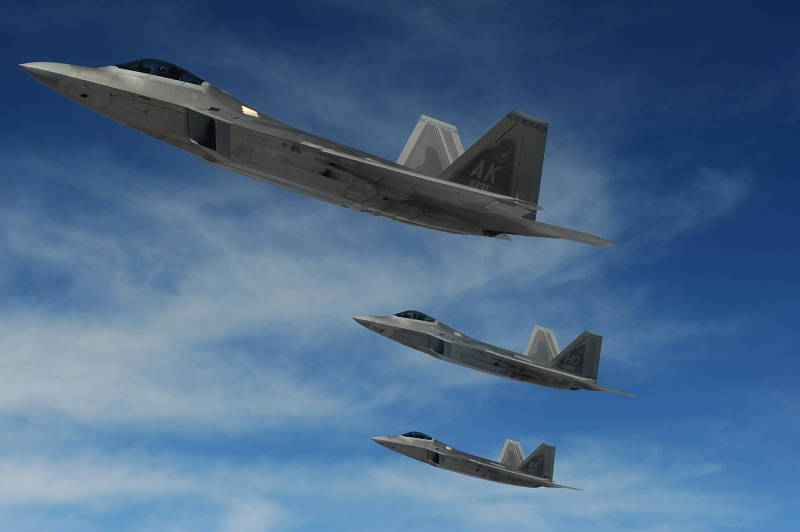 10. Three (3) F-22 Raptor Stealth Fighter Jets -- 90th Fighter Squadron Out of Elmendorf Air Force Base (AFB), Alaska, and the 49th Fighter Wing out of Holloman Air Force Base, New Mexico -- Fly To the Nevada Test and Training Range during the Red Flag 10-2 Exercise, February 4, 2010, Nellis Air Force Base, State of Nevada, USA. Photo Credit: Staff Sgt. Erin Taylor Worley, United States Air Force; Defense Visual Information (DVI, http://www.DefenseImagery.mil, 100204-F-7348W-104) and United States Air Force (USAF, http://www.af.mil), United States Department of Defense (DoD, http://www.DefenseLink.mil or http://www.dod.gov), Government of the United States of America (USA).