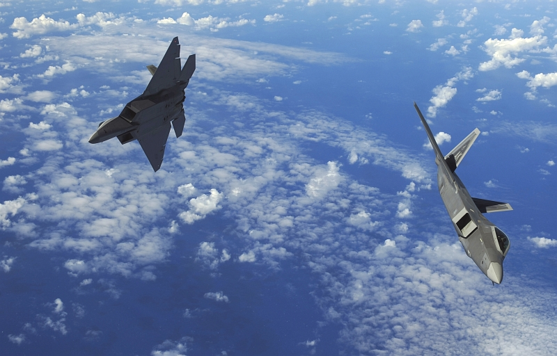 29. U.S. Air Force F-22A Raptor Stealth Fighters Fly Over the Western Pacific Ocean, February 16, 2010, Territory of Guam, USA. Photo Credit: Staff Sgt. Jacob N. Bailey, United States Air Force; Defense Visual Information (DVI, http://www.DefenseImagery.mil, 100216-F-5964B-549) and United States Air Force (USAF, http://www.af.mil), United States Department of Defense (DoD, http://www.DefenseLink.mil or http://www.dod.gov), Government of the United States of America (USA).