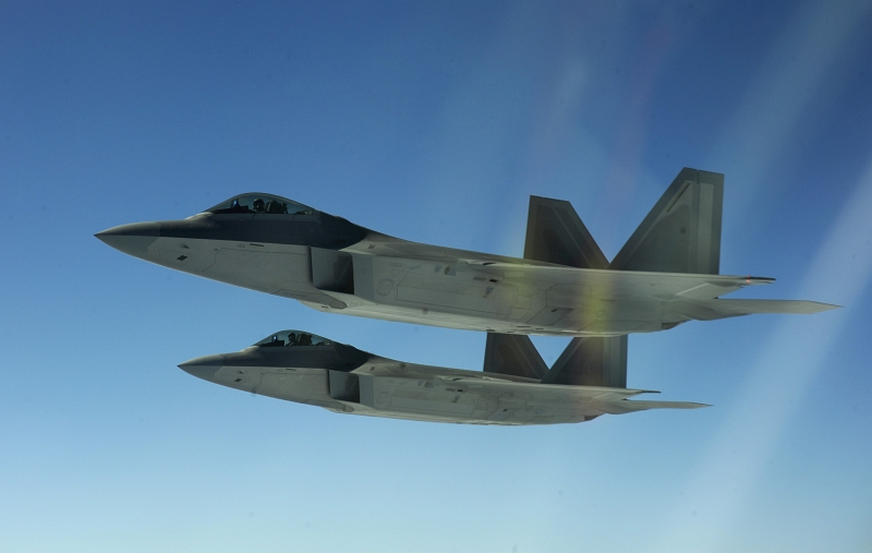 14. Two U.S. Air Force F-22A Raptor Stealth Fighter Jets Flying In Formation, February 17, 2010, Near Territory of Guam, USA. Photo Credit: Staff Sgt. Andy M. Kin, United States Air Force; Defense Visual Information (DVI, http://www.DefenseImagery.mil, 100217-F-4684K-177) and United States Air Force (USAF, http://www.af.mil), United States Department of Defense (DoD, http://www.DefenseLink.mil or http://www.dod.gov), Government of the United States of America (USA).