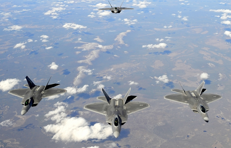 37. Four U.S. Air Force F-22A Raptor Stealth Fighter Jets Fly Together, May 26, 2010, State of Alaska, USA. Photo Credit: Staff Sgt. Brian Ferguson, Air Force Link - Photos (http://www.af.mil/photos, 100526-F-2185F-134, 'Alaska refuel'), United States Air Force (USAF, http://www.af.mil), United States Department of Defense (DoD, http://www.DefenseLink.mil or http://www.dod.gov), Government of the United States of America (USA).