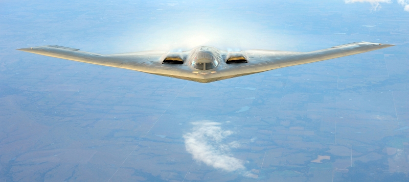 42. A U.S. Air Force B-2 Spirit Stealth Bomber With White Vapor (Condensation), September 9, 2011, State of Kansas, USA. Photo Credit: Senior Airman Courtney Witt, United States Air Force; Defense Visual Information (DVI, http://www.DefenseImagery.mil, 110909-F-QH266-191) and United States Air Force (USAF, http://www.af.mil), United States Department of Defense (DoD, http://www.DefenseLink.mil or http://www.dod.gov), Government of the United States of America (USA).