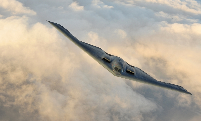 50. Two U.S. Air Force B-2 Spirit Stealth Bombers Soar Above the Clouds, September 9, 2011, State of Kansas, USA. Photo Credit: Senior Airman Courtney Witt, United States Air Force; Defense Visual Information (DVI, http://www.DefenseImagery.mil, 110909-F-QH266-265) and United States Air Force (USAF, http://www.af.mil), United States Department of Defense (DoD, http://www.DefenseLink.mil or http://www.dod.gov), Government of the United States of America (USA).