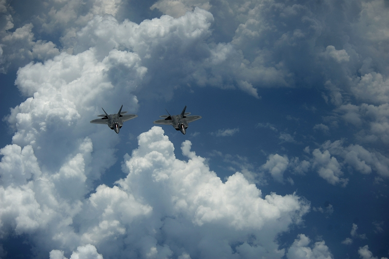 51. Two U.S. Air Force F-22A Raptor Stealth Fighter Jets Fly Over the Clouds Off the East Coast of United States of America, May 10, 2012. Photo Credit: MSgt. Jeremy Lock, United States Air Force; Defense Visual Information (DVI, http://www.DefenseImagery.mil, 120510-F-JQ435-052) and United States Air Force (USAF, http://www.af.mil), United States Department of Defense (DoD, http://www.DefenseLink.mil or http://www.dod.gov), Government of the United States of America (USA).