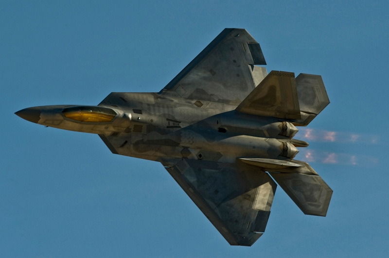 "52. A U.S. Air Force F-22A Raptor Stealth Fighter Jet Flies By at Aviation Nation 2012, November 11, 2012, Nellis Air Force Base, State of Nevada, USA. Photo Credit: Airman 1st Class Christopher Tam, United States Air Force; Air Force Link - Photos (http://www.af.mil/photos, 121111-F-AQ406-409, ""Nellis Aviation Nation 2012""), United States Air Force (USAF, http://www.af.mil), United States Department of Defense (DoD, http://www.DefenseLink.mil or http://www.dod.gov), Government of the United States of America (USA)."