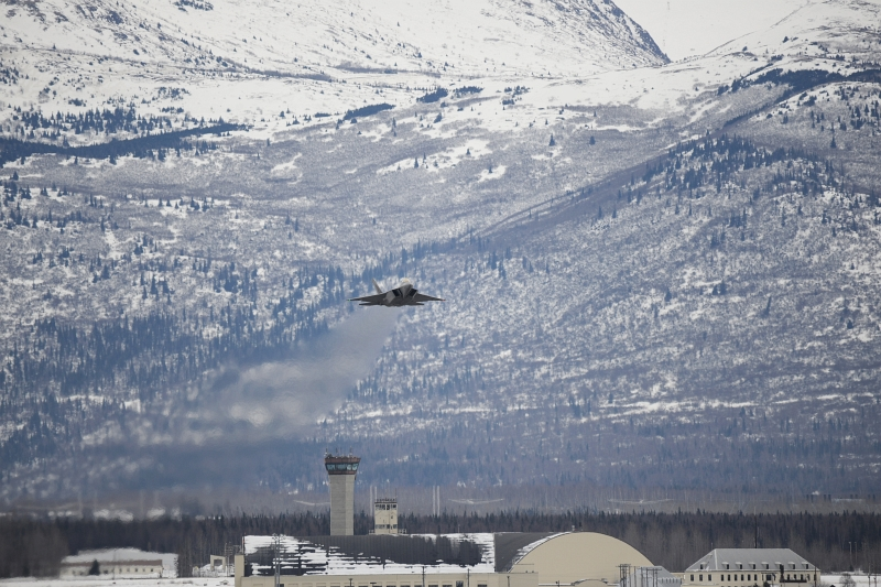 49. Backdropped By Mountains, A U.S. Air Force F-22A Raptor Stealth Fighter Jet Takes Off From Joint Base Elmendorf-Richardson, March 9, 2013, State of Alaska, USA. Photo Credit: TSgt. Dana Rosso, Air Force Link - Photos (http://www.af.mil/photos, 130310-F-PB632-042, 'March UTA'), United States Air Force (USAF, http://www.af.mil), United States Department of Defense (DoD, http://www.DefenseLink.mil or http://www.dod.gov), Government of the United States of America (USA).