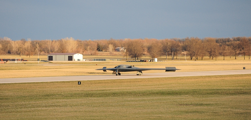 43. A U.S. Air Force B-2 Spirit Stealth Bomber Lands On the Runway, April 1, 2013, Whiteman Air Force Base, State of Missouri, USA. Photo Credit: Staff Sgt. Nick Wilson, Air Force Link - Photos (http://www.af.mil/photos, 130401-F-EA289-117, 'First B-2 surpasses 7,000 flight hours'), United States Air Force (USAF, http://www.af.mil), United States Department of Defense (DoD, http://www.DefenseLink.mil or http://www.dod.gov), Government of the United States of America (USA).