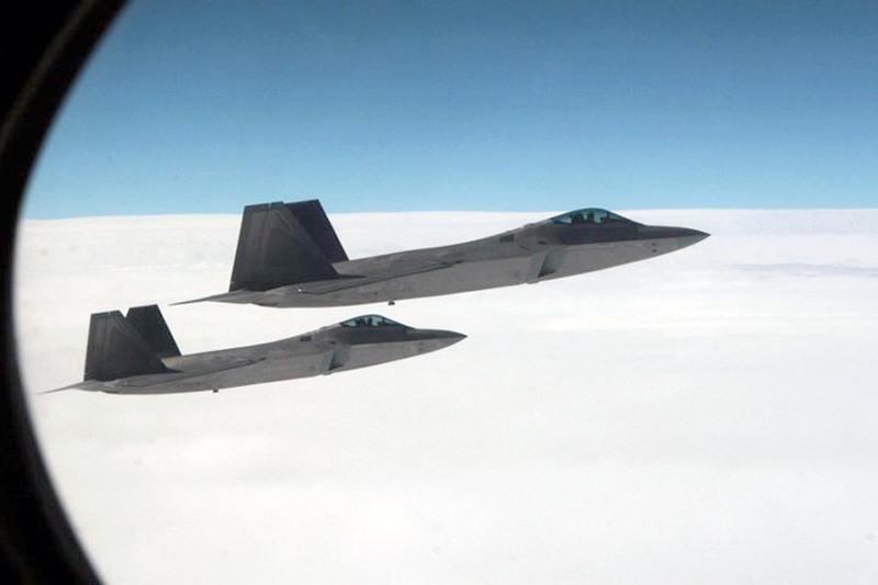 """26. Joint NORAD-Russian Federation Exercise VIGILANT EAGLE: High Above Alaska, Two U.S. Air Force F-22A Raptor Stealth Fighter Jets Intercept and Escort a Gulfstream IV (Gulfstream 4) Jet (Code-named """"Fencing 1220"""") During the International Hijacking Scenario, August 2010, State of Alaska, USA. Photo Credit: Major Michael S. Humphreys, United States Army; Defense Visual Information (DVI, http://www.DefenseImagery.mil) and North American Aerospace Defense Command (NORAD, http://www.norad.mil, 100808-A-0000H-007), United States Department of Defense (DoD, http://www.DefenseLink.mil or http://www.dod.gov), Government of the United States of America (USA)."""