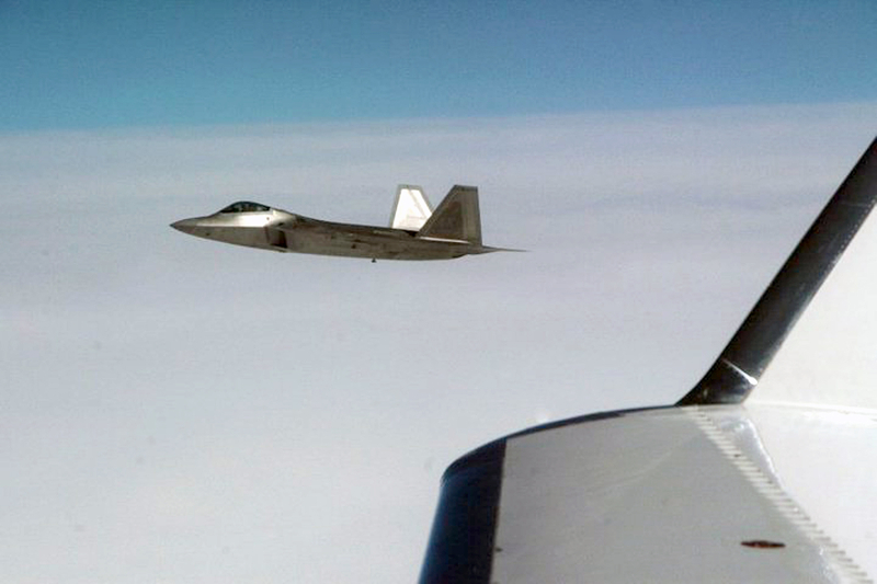 """27. Joint NORAD-Russian Federation Exercise VIGILANT EAGLE: High Above the Pacific Ocean, a U.S. Air Force F-22A Raptor Stealth Fighter Jet Intercepts and Escorts a Gulfstream IV (Gulfstream 4 or Gulfstream G-400) Jet (Code-named """"Fencing 1220"""") During the International Hijacking Scenario, August 2010. Photo Credit: Major Michael S. Humphreys, United States Army; North American Aerospace Defense Command (NORAD, http://www.norad.mil, 100808-A-0000H-008), United States Department of Defense (DoD, http://www.DefenseLink.mil or http://www.dod.gov), Government of the United States of America (USA)."""