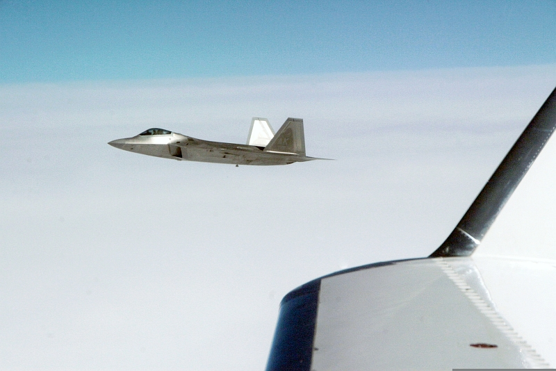 "27. Joint NORAD-Russian Federation Exercise VIGILANT EAGLE: High Above the Pacific Ocean, a U.S. Air Force F-22A Raptor Stealth Fighter Jet Intercepts and Escorts a Gulfstream IV (Gulfstream 4 or Gulfstream G-400) Jet (Code-named ""Fencing 1220"") During the International Hijacking Scenario, August 9, 2010. Photo Credit: Major Michael S. Humphreys, United States Army; North American Aerospace Defense Command (NORAD, http://www.norad.mil, 100809-A-6937H-040), United States Department of Defense (DoD, http://www.DefenseLink.mil or http://www.dod.gov), Government of the United States of America (USA)."