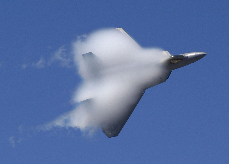 39. Covered With White Vapor, A U.S. Air Force F-22A Raptor Stealth Fighter Jet Executes An Aerial Maneuver at the 42nd Naval Base Ventura County (NBVC) Air Show, April 1, 2007, Point Mugu, State of California, USA. Photo Credit: Mass Communication Specialist 2nd Class Jason R. Williams, United States Navy; Defense Visual Information (DVI, http://www.DefenseImagery.mil, 070401-N-QE507-097, DNSD0804571, and DN-SD-08-04571) and United States Navy (USN, http://www.navy.mil), United States Department of Defense (DoD, http://www.DefenseLink.mil or http://www.dod.gov), Government of the United States of America (USA).