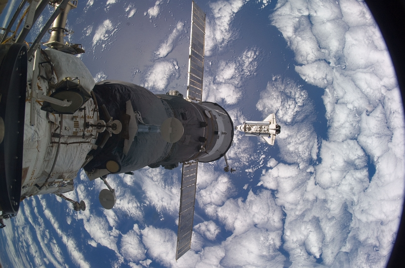 6. With Beautiful Blue-and-White Earth Below, Space Shuttle Atlantis (STS-129) Approaches the International Space Station, November 18, 2009, As Seen From the International Space Station (Expedition Twenty-One). Photo Credit: NASA; STS-129 Shuttle Mission Imagery (http://spaceflight.nasa.gov/gallery/images/shuttle/sts-129/ndxpage1.html), ISS021-E-029808 (http://spaceflight.nasa.gov/gallery/images/shuttle/sts-129/html/iss021e029808.html), NASA Human Space Flight (http://spaceflight.nasa.gov), National Aeronautics and Space Administration (NASA, http://www.nasa.gov), Government of the United States of America.