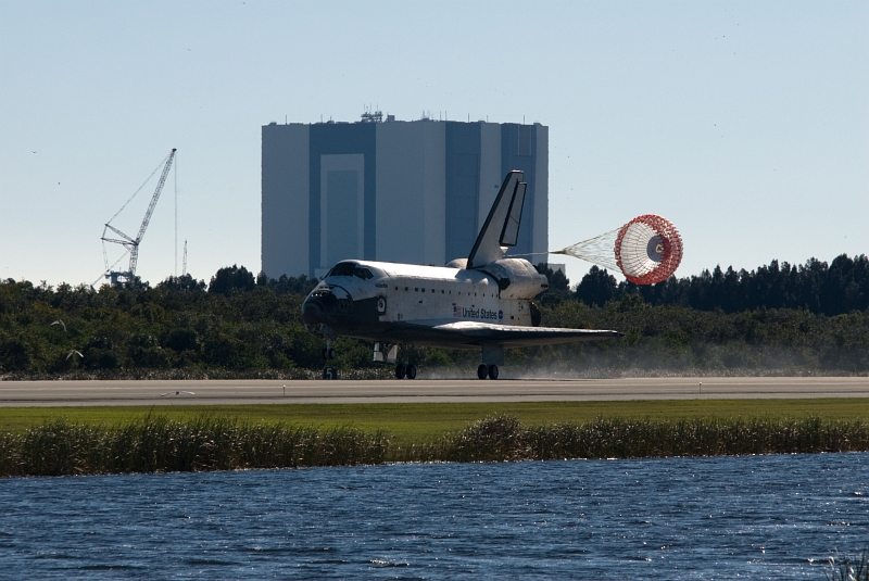 15. With the Main Landing Gear Down and Drag Parachute Deployed and Unfurled, Space Shuttle Atlantis (STS-129) Makes A Picture Perfect Landing On Runway 33, November 27, 2009, NASA John F. Kennedy Space Center, State of Florida, USA. Photo Credit: Tim Terry, NASA; STS-129 Mission, Return of Space Shuttle Atlantis, November 27, 2009, Kennedy Media Gallery (http://mediaarchive.ksc.nasa.gov) Photo Number: KSC-2009-6601 (http://mediaarchive.ksc.nasa.gov/detail.cfm?mediaid=44508), John F. Kennedy Space Center (KSC, http://www.nasa.gov/centers/kennedy), National Aeronautics and Space Administration (NASA, http://www.nasa.gov), Government of the United States of America.