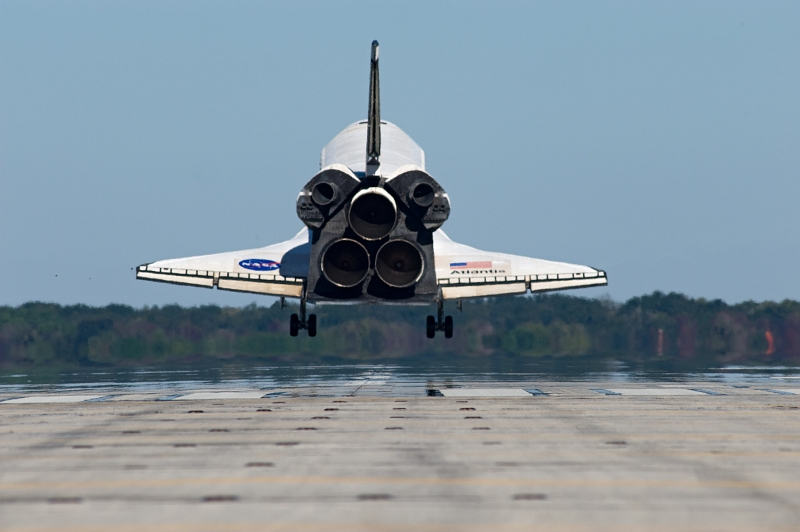 14. Space Shuttle Atlantis (STS-129) Seconds Away From A Mid-Morning Landing On Runway 33, November 27, 2009, NASA John F. Kennedy Space Center, State of Florida, USA. Photo Credit: NASA/Kevin O'Connell and Rick Prickett; STS-129 Mission, Return of Space Shuttle Atlantis, November 27, 2009, Kennedy Media Gallery (http://mediaarchive.ksc.nasa.gov) Photo Number: KSC-2009-6610 (http://mediaarchive.ksc.nasa.gov/detail.cfm?mediaid=44517), John F. Kennedy Space Center (KSC, http://www.nasa.gov/centers/kennedy), National Aeronautics and Space Administration (NASA, http://www.nasa.gov), Government of the United States of America.