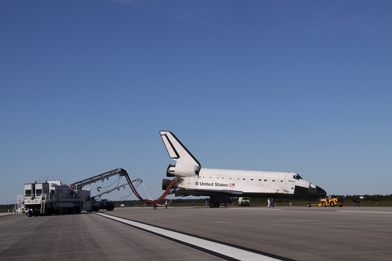 16. After A Picture Perfect Landing On Runway 33, Space Shuttle Atlantis (STS-129) Is Towed From the Shuttle Landing Facility to Orbiter Processing Facility-1 (OPF-1), November 27, 2009, NASA John F. Kennedy Space Center, State of Florida, USA. Photo Credit: Jack Pfaller, NASA; STS-129 Mission, Return of Space Shuttle Atlantis, November 27, 2009, Kennedy Media Gallery (http://mediaarchive.ksc.nasa.gov) Photo Number: KSC-2009-6626 (http://mediaarchive.ksc.nasa.gov/detail.cfm?mediaid=44533), John F. Kennedy Space Center (KSC, http://www.nasa.gov/centers/kennedy), National Aeronautics and Space Administration (NASA, http://www.nasa.gov), Government of the United States of America.