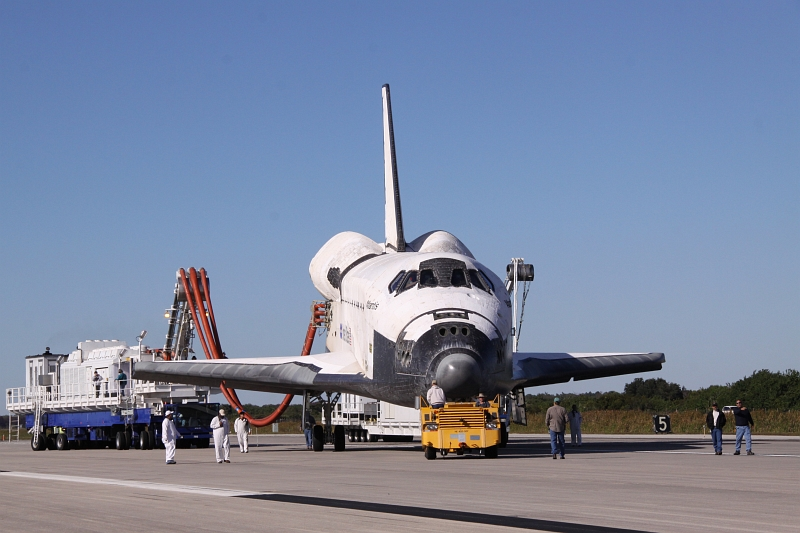 17. Another View of Space Shuttle Atlantis (STS-129) As the Orbiter Is Towed From the Shuttle Landing Facility to Orbiter Processing Facility-1 (OPF-1), November 27, 2009, NASA John F. Kennedy Space Center, State of Florida, USA. Photo Credit: Jack Pfaller, NASA; STS-129 Mission, Return of Space Shuttle Atlantis, November 27, 2009, Kennedy Media Gallery (http://mediaarchive.ksc.nasa.gov) Photo Number: KSC-2009-6626 (http://mediaarchive.ksc.nasa.gov/detail.cfm?mediaid=44533), John F. Kennedy Space Center (KSC, http://www.nasa.gov/centers/kennedy), National Aeronautics and Space Administration (NASA, http://www.nasa.gov), Government of the United States of America.