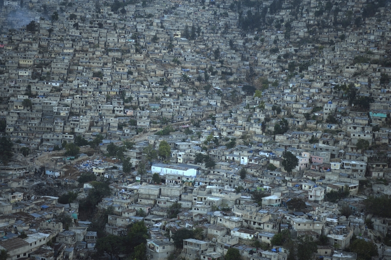 29. Aerial View of Port-au-Prince, January 15, 2010, Republique d'Haiti (Repiblik d' Ayiti) - Republic of Haiti. Photo Credit: Technical Sgt. (TSgt) James L. Harper Jr., United States Air Force; Defense Visual Information (DVI, http://www.DefenseImagery.mil, 100115-F-4177H-204) and United States Air Force (USAF, http://www.af.mil), United States Department of Defense (DoD, http://www.DefenseLink.mil or http://www.dod.gov), Government of the United States of America (USA).