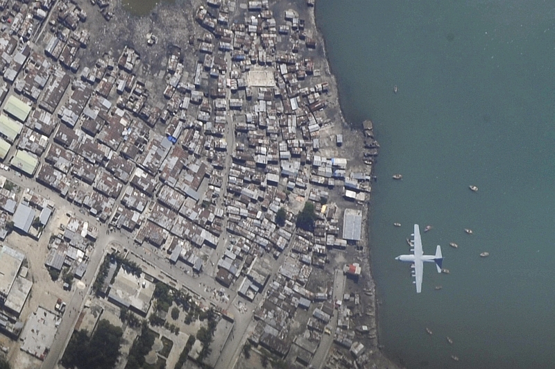 25. A C-130 Hercules Aircraft Makes A Final Approach Into Toussaint Louverture International Airport (Aeroport International Toussaint Louverture), January 16, 2010, Port-au-Prince, Republique d'Haiti (Repiblik d' Ayiti) - Republic of Haiti, As Seen From A U.S. Air Force OC-135B Open Skies Observation Aircraft. Photo Credit: Airman 1st Class (A1C) Perry Aston, United States Air Force; Defense Visual Information (DVI, http://www.DefenseImagery.mil, 100116-F-6188A-026) and United States Air Force (USAF, http://www.af.mil), United States Department of Defense (DoD, http://www.DefenseLink.mil or http://www.dod.gov), Government of the United States of America (USA).