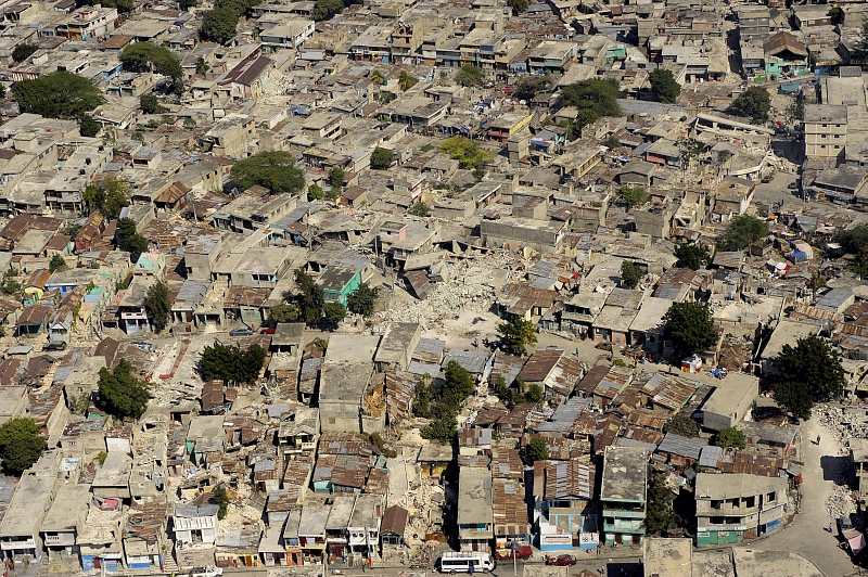 43. Another Aerial View of Earthquake-Damaged Buildings In the City of Port-au-Prince, January 22, 2010, Republique d'Haiti (Repiblik d' Ayiti) - Republic of Haiti. Photo Credit: Master Sgt. (MSgt) Russell E. Cooley IV, United States Air Force; Defense Visual Information (DVI, http://www.DefenseImagery.mil, 100122-F-9712C-108) and United States Air Force (USAF, http://www.af.mil), United States Department of Defense (DoD, http://www.DefenseLink.mil or http://www.dod.gov), Government of the United States of America (USA).