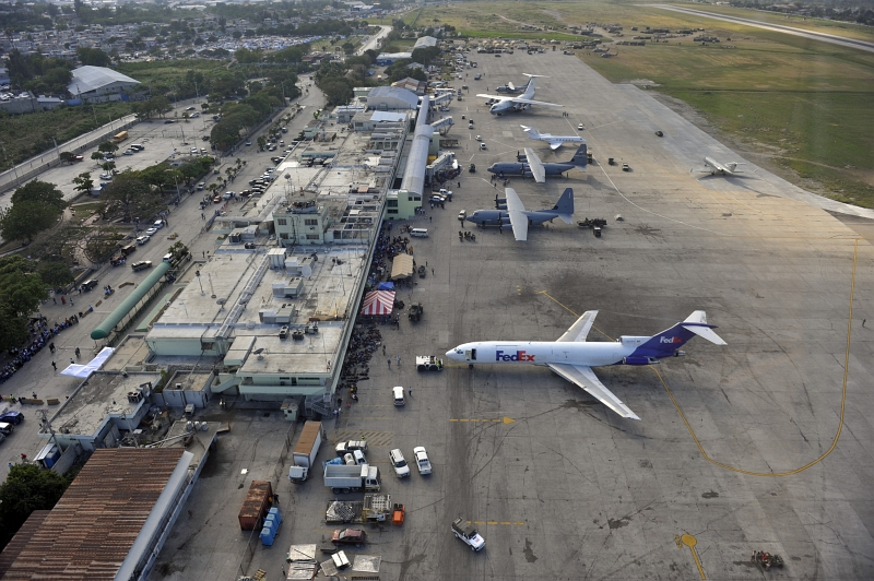 54. Aerial View of the Busy Toussaint Louverture International Airport, January 23, 2010, Republique d'Haiti (Repiblik d' Ayiti) - Republic of Haiti. Photo Credit: Staff Sgt. Desiree N. Palacios, Air Force Link (AFLink) Photos (http://www.af.mil/photos, 100123-F-1830P-258, 'Combat controllers at work'), United States Air Force (USAF, http://www.af.mil), United States Department of Defense (DoD, http://www.DefenseLink.mil or http://www.dod.gov), Government of the United States of America (USA).