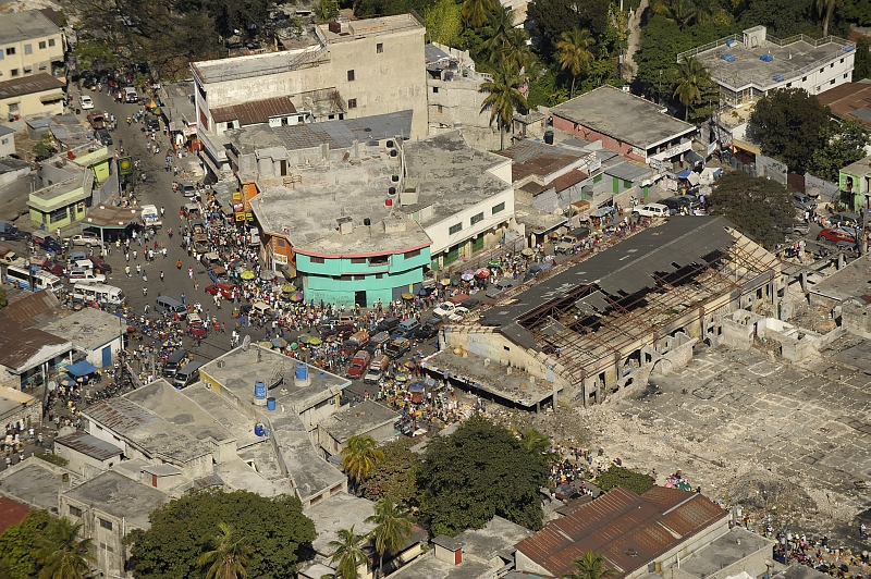 47. Street Busy With Trucks, Vans, Cars, Vendors, and Earthquake Survivors, January 23, 2010, Republique d'Haiti (Repiblik d' Ayiti) - Republic of Haiti.  Photo Credit: Master Sgt. Russell E. Cooley IV, United States Air Force; Defense Visual Information (DVI, http://www.DefenseImagery.mil, 100123-F-9712C-0076) and United States Air Force (USAF, http://www.af.mil), United States Department of Defense (DoD, http://www.DefenseLink.mil or http://www.dod.gov), Government of the United States of America (USA).