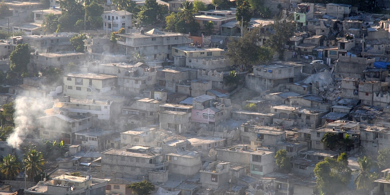 16. Smoke Billows From Earthquake-Damaged Homes and Businesses, January 15, 2010, Port-au-Prince, Republique d'Haiti (Repiblik d' Ayiti) - Republic of Haiti. Photo Credit: Mass Communication Specialist 2nd Class Candice Villarreal, Navy News Service - Eye on the Fleet (http://www.news.navy.mil/view_photos.asp, 100115-N-6247V-153), United States Navy (USN, http://www.navy.mil), United States Department of Defense (DoD, http://www.DefenseLink.mil or http://www.dod.gov), Government of the United States of America (USA).