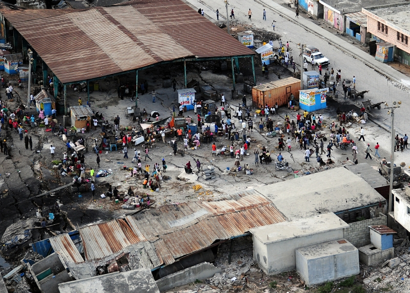 21. Earthquake Survivors gather In A Dilapidated Marketplace, January 16, 2010, Port-au-Prince, Republique d'Ha�ti (Repiblik d' Ayiti) - Republic of Haiti. Photo Credit: Mass Communication Specialist 2nd Class Candice Villarreal, Navy News Service - Eye on the Fleet (http://www.news.navy.mil/view_photos.asp, 100116-N-6247V-147), United States Navy (USN, http://www.navy.mil), United States Department of Defense (DoD, http://www.DefenseLink.mil or http://www.dod.gov), Government of the United States of America (USA).