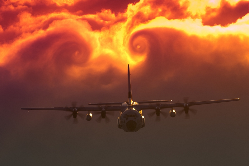 Two Vortices (Vortexes) Created By the U.S. Coast Guard C-130J Super Hercules Aircraft Swirl In the Clouds, April 16, 2009, State of North Carolina, USA. Photo Credit: Dave Silva, U.S. Coast Guard; United States Coast Guard (USCG, http://www.uscg.mil) Visual Information Gallery (http://cgvi.uscg.mil/media/main.php, 20090916-G-9091S-008), United States Department of Homeland Security (DHS, http://www.dhs.gov), Government of the United States of America (USA).
