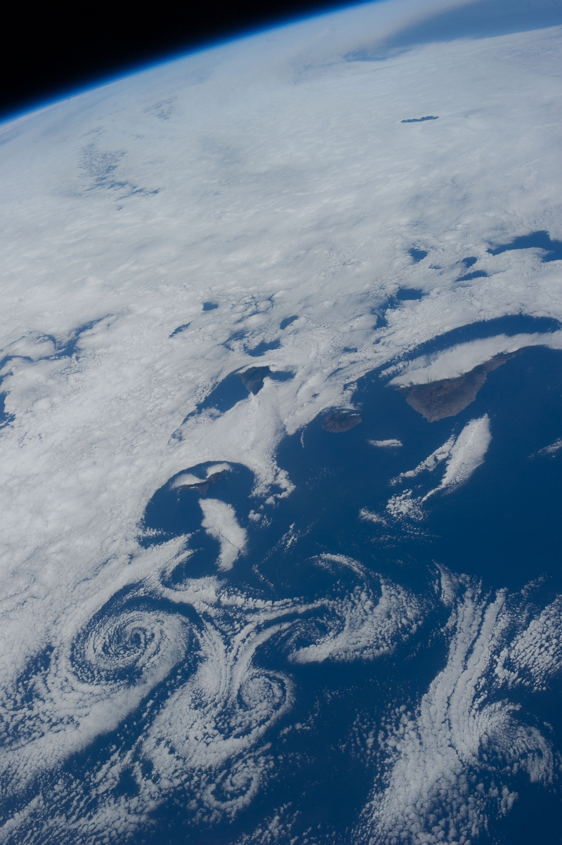 8. Clouds and Vortices Over the Atlantic Ocean As Seen From the International Space Station (Expedition 36) on July 6, 2013 at 17:30:57 GMT, Latitude (LAT): 22.5, Longitude (LON): -15.2, Altitude (ALT): 220 Nautical Miles, Sun Azimuth (AZI): 284 degrees, Sun Elevation Angle (ELEV): 29 degrees. Photo Credit: NASA; ISS036-E-16275, International Space Station (Expedition 36); Image Science and Analysis Laboratory, NASA-Johnson Space Center. 'The Gateway to Astronaut Photography of Earth.' <http://eol.jsc.nasa.gov/scripts/sseop/photo.pl?mission=ISS036&roll=E&frame=16275>; National Aeronautics and Space Administration (NASA, http://www.nasa.gov), Government of the United States of America (USA).