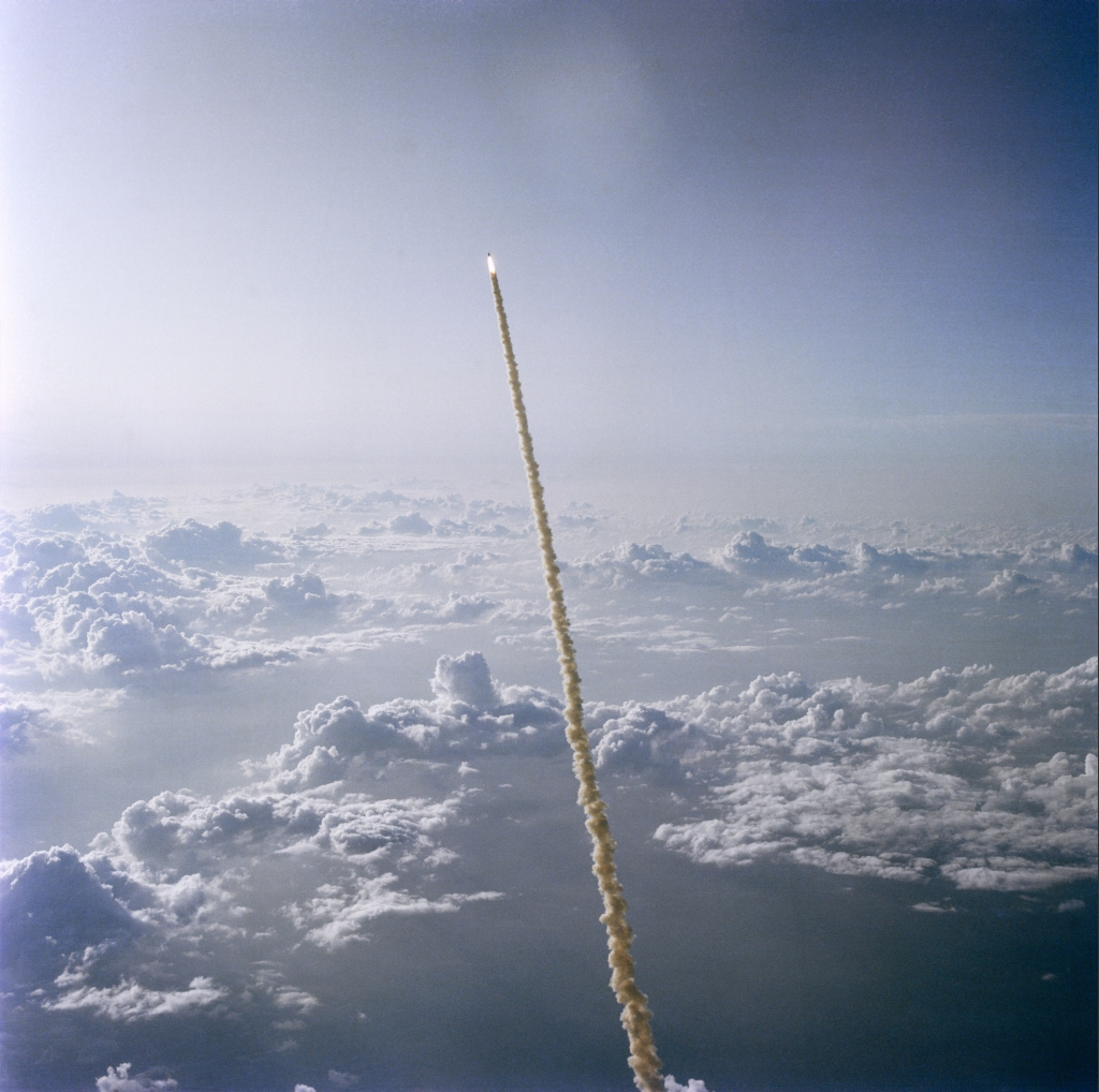A Spectacular Aerial View of Space Shuttle Challenger (STS-7) -- High Above the Clouds and Florida's Atlantic Ocean Coastline -- Roaring Into Space on June 18, 1983, As Seen From NASA's Shuttle Training Aircraft (STA), State of Florida, USA. Photo Credit: Astronaut John W. Young, NASA; STS-7 Shuttle Mission Imagery (http://spaceflight.nasa.gov/gallery/images/shuttle/sts-7/ndxpage1.html): S83-35620 (http://spaceflight.nasa.gov/gallery/images/shuttle/sts-7/html/s83-35620.html), NASA Human Space Flight (http://spaceflight.nasa.gov), National Aeronautics and Space Administration (NASA, http://www.nasa.gov), Government of the United States of America.