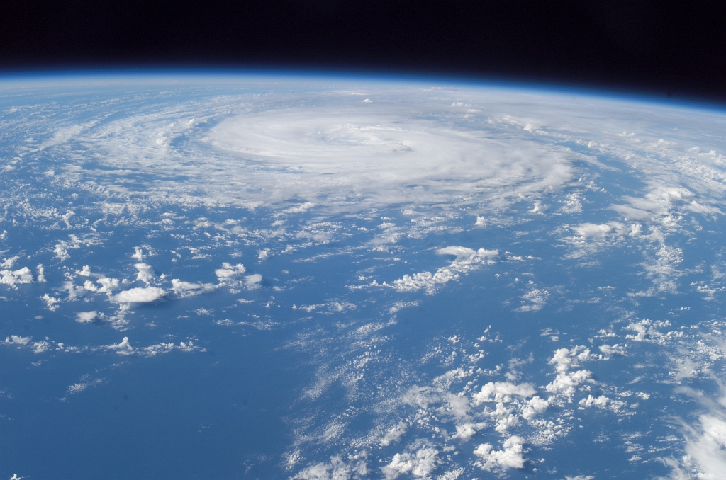 "Hurricane Epsilon Over the North Atlantic Ocean Backdropped By the Blackness of Space, December 3, 2005 at 15:37:45 GMT, As Seen From the International Space Station (Expedition 12), Latitude (LAT): 24.9, Longitude (LON): -36.1, Altitude (ALT): 191 Nautical Miles, Sun Azimuth (AZI): 205 degrees, Sun Elevation Angle (ELEV): 39 degrees. Photo Credit: NASA; ISS012-E-10131, Earth, Atmospheric limb, International Space Station (Expedition Twelve); Earth Science and Remote Sensing Unit, NASA-Johnson Space Center. ""The Gateway to Astronaut Photography of Earth."" <http://eol.jsc.nasa.gov/scripts/sseop/photo.pl?mission=ISS012&roll=E&frame=10131>; National Aeronautics and Space Administration (NASA, http://www.nasa.gov), Government of the United States of America (USA)."