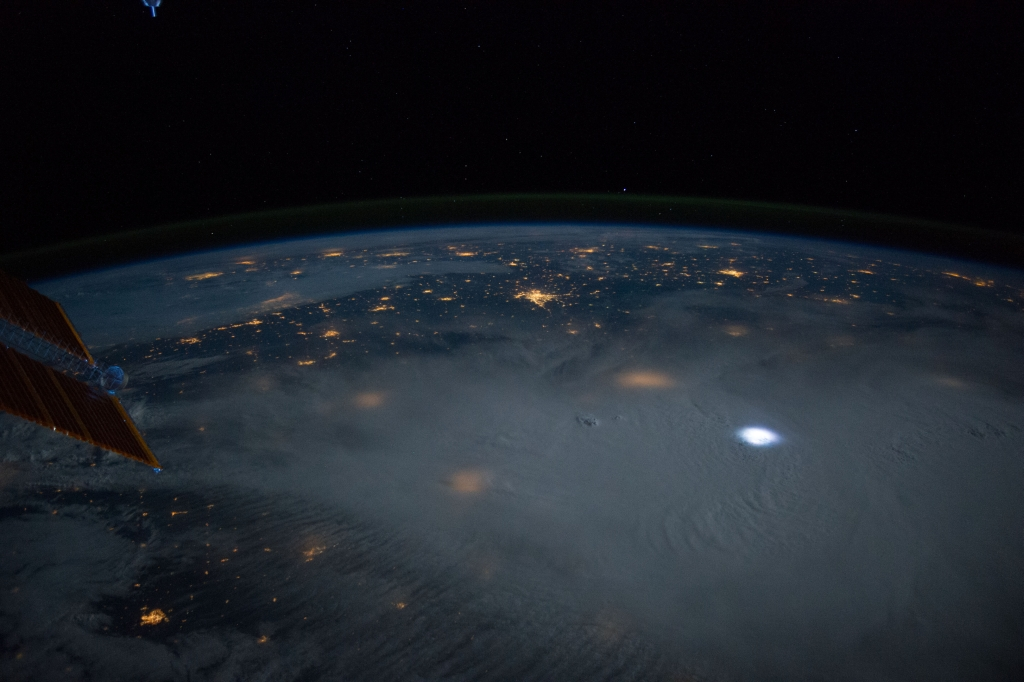"Space, Stars, Moon, Earth, Clouds, Lightning, and City Lights, June 12, 2014 at 06:39:24 GMT, As Seen From the International Space Station (Expedition 40) While Orbiting Above Hay Springs, Nebraska, USA, North America, Latitude (LAT): 42.6, Longitude (LON): -102.7, Altitude (ALT): 219 Nautical Miles, Sun Azimuth (AZI): 357 degrees, Sun Elevation Angle (ELEV): -24 degrees. Photo Credit: NASA; ISS040-E-10359, International Space Station (Expedition 40); Image Science and Analysis Laboratory, NASA-Johnson Space Center. ""The Gateway to Astronaut Photography of Earth."" <http://eol.jsc.nasa.gov/scripts/sseop/photo.pl?mission=ISS040&roll=E&frame=10359>; National Aeronautics and Space Administration (NASA, http://www.nasa.gov), Government of the United States of America (USA)."