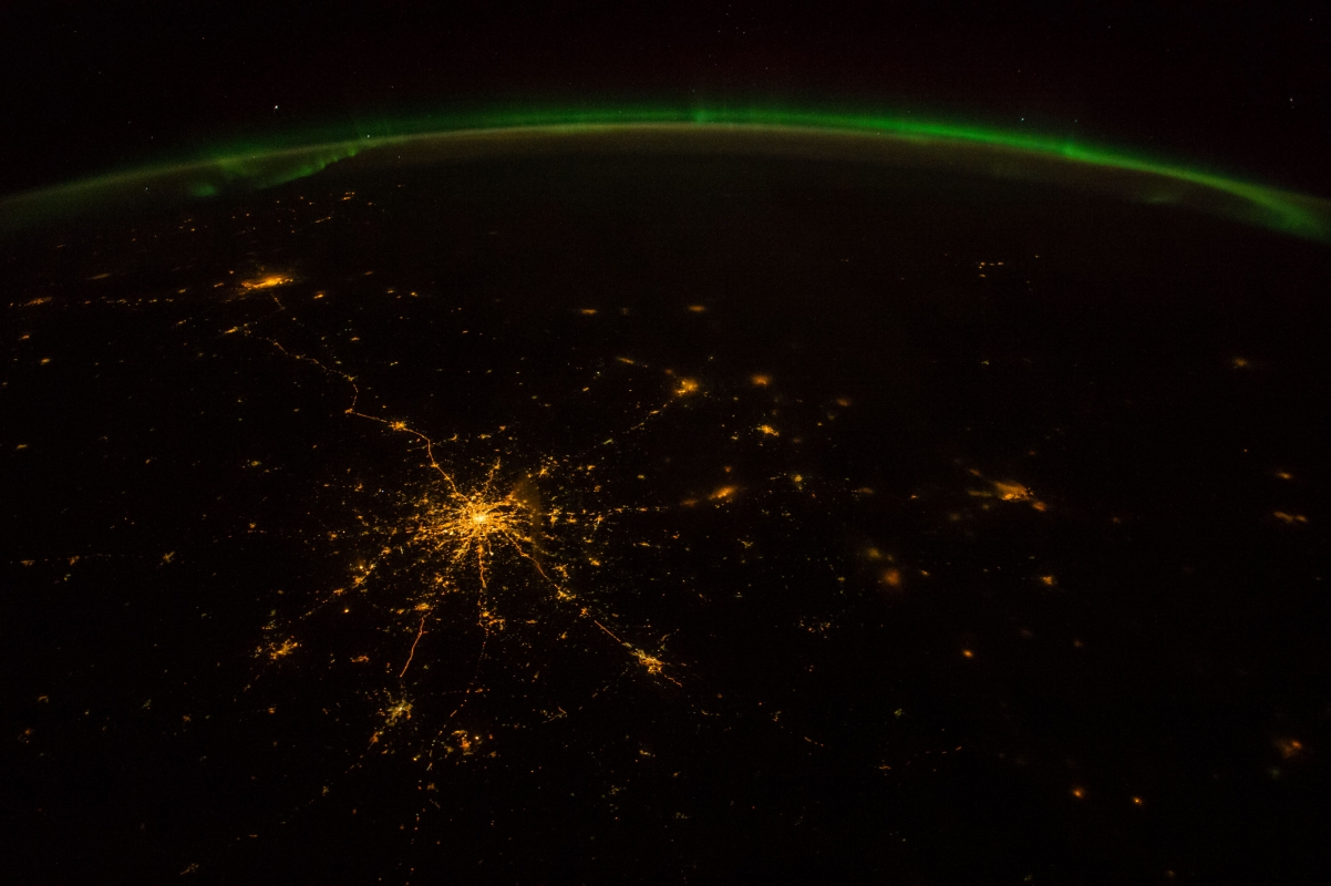 "Space, Earth, Aurora Borealis, and City Lights, October 2, 2014 at 21:02:13 GMT, Rossiyskaya Federatsiya - Russian Federation, As Seen From the International Space Station (Expedition 41), Latitude (LAT): 51.7, Longitude (LON): 44.3, Altitude (ALT): 219 Nautical Miles, Sun Azimuth (AZI): 3 degrees, Sun Elevation Angle (ELEV): -42 degrees. Photo Credit: NASA; ISS041-E-58219, International Space Station (Expedition 41); Image Science and Analysis Laboratory, NASA-Johnson Space Center. ""The Gateway to Astronaut Photography of Earth."" <http://eol.jsc.nasa.gov/scripts/sseop/photo.pl?mission=ISS041&roll=E&frame=58219>; National Aeronautics and Space Administration (NASA, http://www.nasa.gov), Government of the United States of America (USA)."