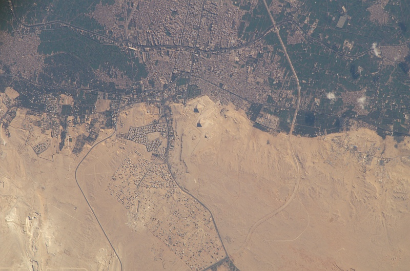 6. The Great Pyramids and El Giza, April 2, 2005, Jumhuriyat Misr al-Arabiyah - Arab Republic of Egypt, As Seen From the International Space Station (Expedition 10). Photo Credit: NASA; ISS010-E-22442, The Great Pryamids, El Giza, International Space Station (Expedition Ten); Image Science and Analysis Laboratory, NASA-Johnson Space Center. 'Astronaut Photography of Earth - Display Record.' <http://eol.jsc.nasa.gov/scripts/sseop/photo.pl?mission=ISS010&roll=E&frame=22442>; National Aeronautics and Space Administration (NASA, http://www.nasa.gov), Government of the United States of America (USA).