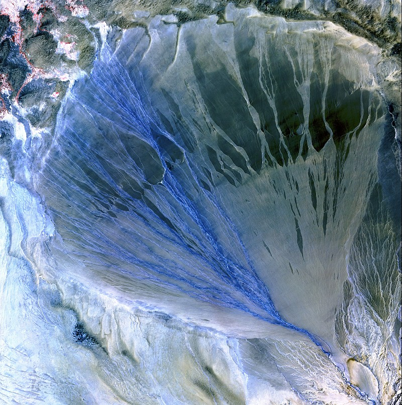 14. A Beautiful Alluvial Fan, With the River Branching Into Many Streams of Flowing Blue Water, Between the Kunlun and Altun Mountain Ranges, May 2, 2002, Xinjiang Province, Zhonghua Renmin Gongheguo - People's Republic of China, As Seen By the ASTER Instrument Aboard NASA's Terra Satellite. Photo Credit: The ASTER (Advanced Spaceborne Thermal Emission and Reflection Radiometer) Project (http://asterweb.jpl.nasa.gov) and NASA/GSFC/METI/ERSDAC/JAROS, and U.S./Japan ASTER Science Team; EROS (Earth Resources Observation and Science, http://eros.usgs.gov) Image Gallery Collections (http://eros.usgs.gov/imagegallery) - Earth As Art 2 Image Collection (http://eros.usgs.gov/imagegallery/collection.php?col=Earth+As+Art+2) - Alluvial Fan, United States Geological Survey (USGS, http://www.usgs.gov), United States Department of the Interior (http://www.doi.gov) and National Aeronautics and Space Administration (NASA, http://www.nasa.gov), Government of the United States of America (USA).