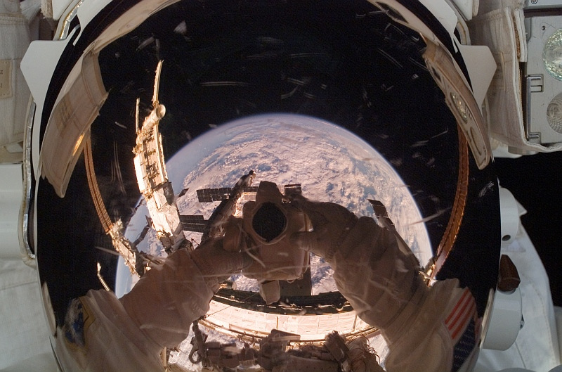 7. A Large Portion of Cloud-Covered Planet Earth Is Reflected In the Helmet Visor of NASA Astronaut Clayton C. Anderson (Clay Anderson), the International Space Station (Expedition 15) Flight Engineer, August 15, 2007. Photo Credit: STS-118 Shuttle Mission Imagery (http://spaceflight.nasa.gov/gallery/images/shuttle/sts-118/ndxpage1.html), ISS015-E-22561 (http://spaceflight.nasa.gov/gallery/images/shuttle/sts-118/html/iss015e22561.html), NASA Human Space Flight (http://spaceflight.nasa.gov), National Aeronautics and Space Administration (NASA, http://www.nasa.gov), Government of the United States of America.